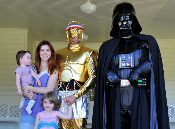 &#39;How I Met Your Mother&#39; star Alyson Hannigan, husband and fellow &#39;Buffy&#39; alum Alexis Denisof and their daughters Satyana and Keeva &#40;held by Hannigan&#41; are seen at the Course Of The Force 2013, an &#39;Epic Lightsaber Relay,&#39; benefiting the Make-A-Wish Foundation, at &#39;Star Wars&#39; creator George Lucas&#39; Skywalker Ranch in California on July 9, 2013. <span class=meta>(Steve Jennings &#47; WireImage)</span>