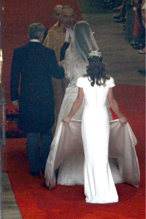Pippa Middleton holds her sister Kate Middleton&#39;s train at her Royal Wedding to Prince William at Westminster Abbey in London on April 29, 2011. Pippa became famous due to her a cowl-neck, body-hugging, ivory bridesmaid gown by Sarah Burton at Alexander McQueen. <span class=meta>(AMH &#47; Startraksphoto.com)</span>