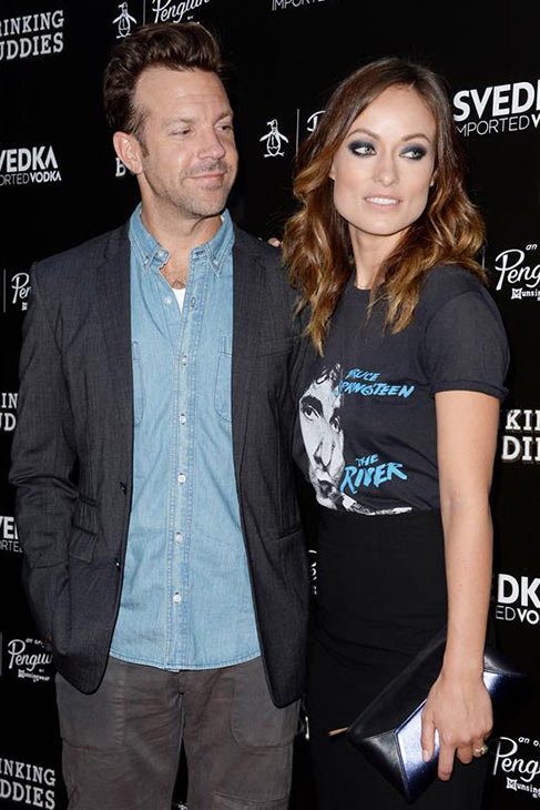 Olivia Wilde, wearing a Bruce Springsteen shirt, and fiance Jason Sudeikis attend the premiere of her film 'Drinking Buddies' at the ArcLight Cinemas in Los Angeles on Aug. 15, 2013.