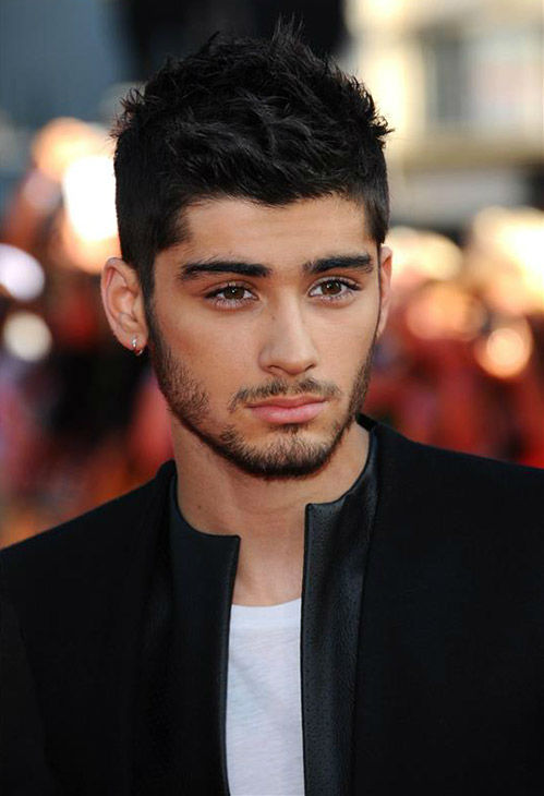 "<div class=""meta image-caption""><div class=""origin-logo origin-image ""><span></span></div><span class=""caption-text"">One Direction member Zayn Malik walks the red carpet at the premiere of 'One Direction: This Is Us' in London on Aug. 20, 2013. It was later revealed that he and girlfriend Perrie Edwards of the female pop group Little Mix are engaged. (Anthony Harvey / Startraksphoto.com)</span></div>"