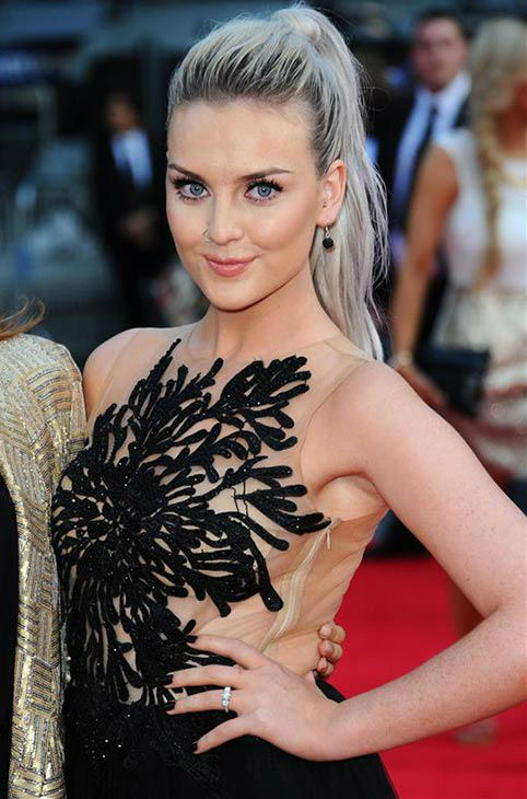 "<div class=""meta ""><span class=""caption-text "">Perrie Edwards of the female pop group Little Mix walks the red carpet at the premiere of 'One Direction: This Is Us' in London on Aug. 20, 2013. It was later revealed that she and boyfriend Zayn Malik, one of the five members of One Direction, are engaged. (Anthony Harvey / Startraksphoto.com)</span></div>"