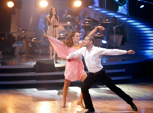 "<div class=""meta ""><span class=""caption-text "">Singer and recently eliminated 'American Idol' contestant Pia Toscano sang 'I'll Stand by You,' accompanied by pros Mark Ballas and Karina Smirnoff.  (ABC Photo/ Adam Taylor)</span></div>"