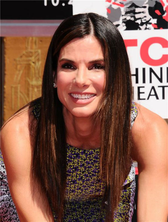 Sandra Bullock leaves her handprints in cement at a ceremony at the TCL Chinese Theatre in Hollywood on Sept. 25, 2013.