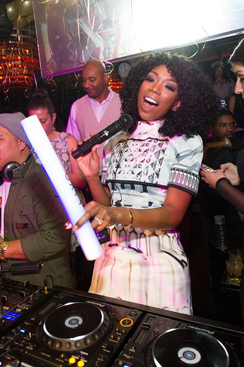 "<div class=""meta image-caption""><div class=""origin-logo origin-image ""><span></span></div><span class=""caption-text"">Brandy is seen in the DJ booth at a New Year's Eve party she hosted at the LAVO nightclub in Las Vegas on Dec. 31, 2012. The singer attended the event with fiance Ryan Press. (Al Powers / Powers Imagery)</span></div>"