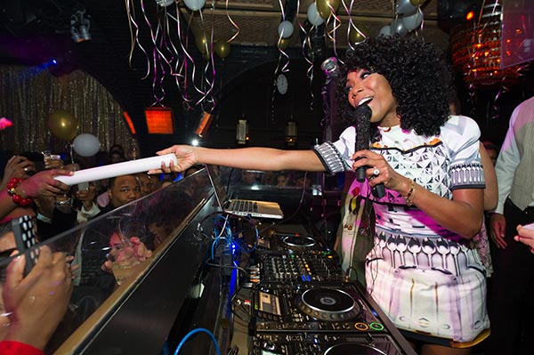 Brandy is seen in the DJ booth at a New Year's Eve party she hosted at the LAVO nightclub in Las Vegas on Dec. 31, 2012. The singer attended the event with fiance Ryan Press.