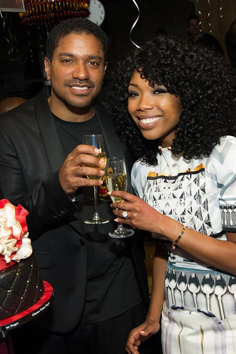 Brandy and fiance Ryan Press toast to 2013 at a New Year&#39;s Eve party she hosted at the LAVO nightclub in Las Vegas on Dec. 31, 2012. <span class=meta>(Al Powers &#47; Powers Imagery)</span>