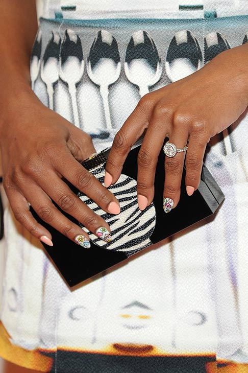 Brandy shows off her engagement ring at a New Year&#39;s Eve party she hosted at the LAVO nightclub in Las Vegas on Dec. 31, 2012. The singer reportedly got engaged to Ryan Press earlier in the month. <span class=meta>(Al Powers &#47; Powers Imagery)</span>