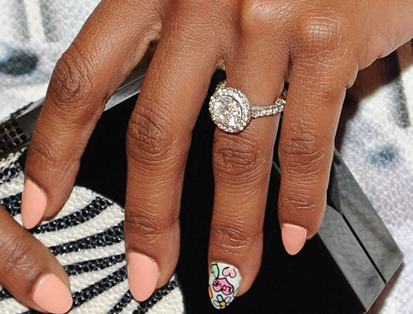 Brandy shows off her engagement ring at a New...