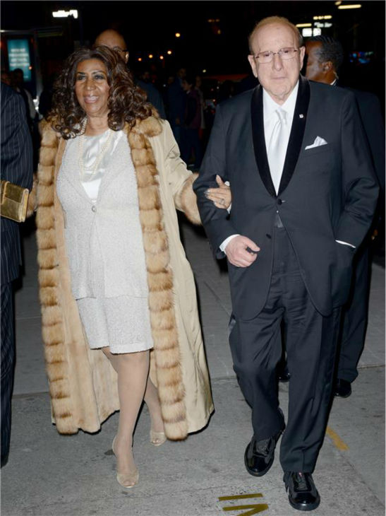 Aretha Franklin and record executive Clive Davis arrive at the 30th annual Night of Stars gala in New York on Oct. 22, 2013.