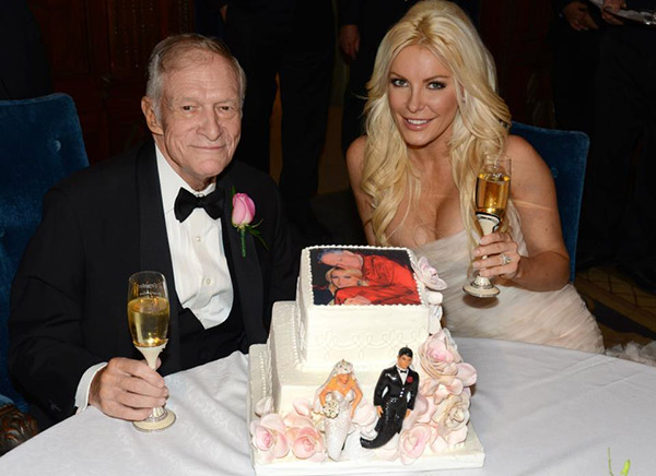 Hugh Hefner and Crystal Harris pose with their wedding cake. The two tied the knot at the Playboy Mansion on Dec. 31, 2012 -- New Year's Eve.