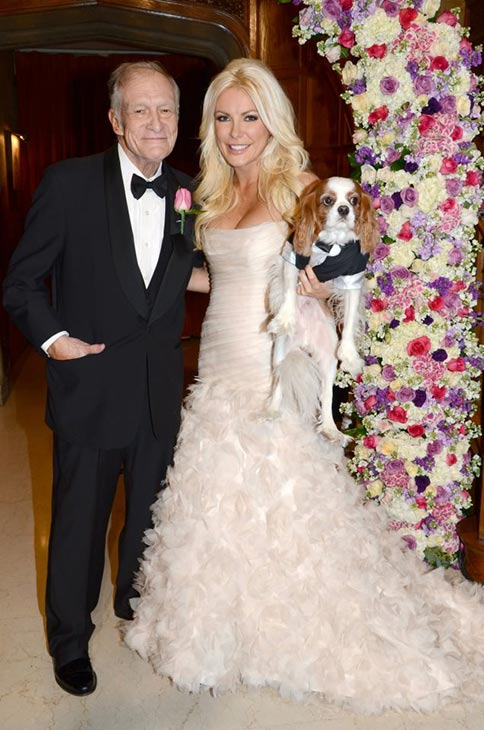 Hugh Hefner and Crystal Harris pose with their...