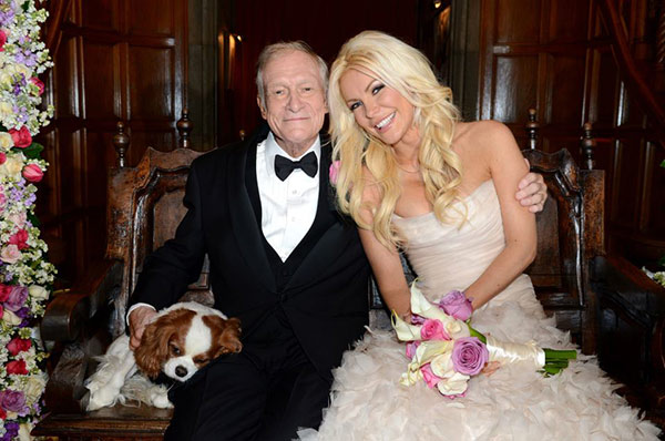 Hugh Hefner and Crystal Harris pose with their Cavalier King Charles Spaniel Charlie for an official wedding photo. The two tied the knot at the Playboy Mansion on Dec. 31, 2012 -- New Year&#39;s Eve. <span class=meta>(Elayne Lodge &#47; Playboy Enterprises, Inc.)</span>