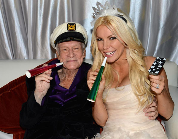 Hugh Hefner and Crystal Harris pose for a photo at their New Year's Eve celebration at the Playboy Mansion on Dec. 31, 2012. The two wed inside the home earlier in the day.