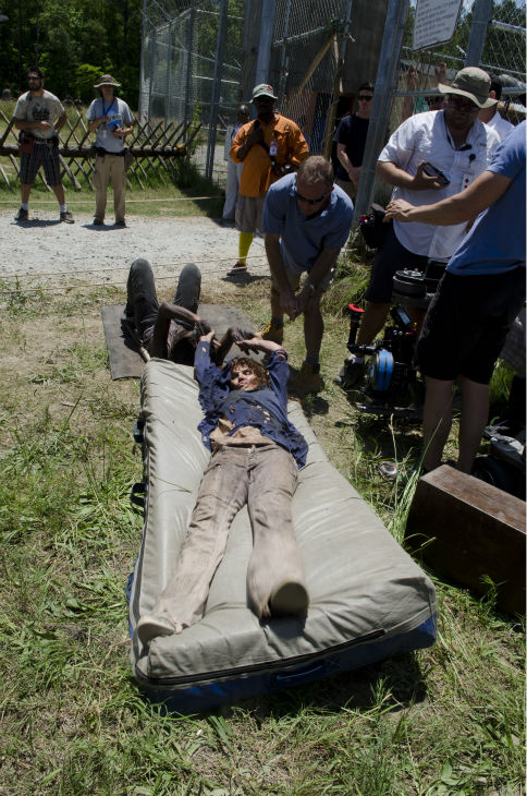 An actor dressed as a Walker performs a stunt on the set of AMC&#39;s &#39;The Walking Dead&#39; while filming episode 2 of season 4, titled &#39;Infected,&#39; which aired on Oct. 20, 2013. <span class=meta>(Gene Page &#47; AMC)</span>