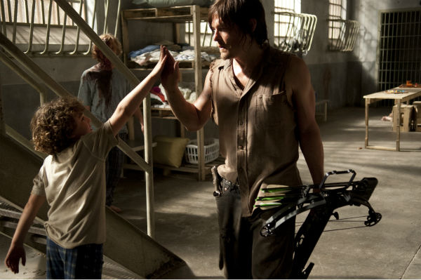 "<div class=""meta ""><span class=""caption-text "">Luke Donaldson (Luke) and Norman Reedus (Daryl Dixon) exhange a high-five on the set of AMC's 'The Walking Dead' while filming episode 2 of season 4, titled 'Infected,' which aired on Oct. 20, 2013. (Gene Page / AMC)</span></div>"