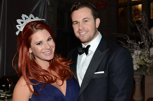 Evan Longoria of the Tampa Bay Rays MLB team poses with girlfriend and Playboy Playmate Jaime Edmondson at the New Year's Eve celebration at the Playboy Mansion on Dec. 31, 2012.