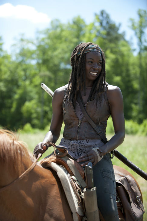 "<div class=""meta ""><span class=""caption-text "">Danai Gurira (Michonne) rides a horse on the set of AMC's 'The Walking Dead' while filming episode 2 of season 4, titled 'Infected,' which aired on Oct. 20, 2013. (Gene Page / AMC)</span></div>"
