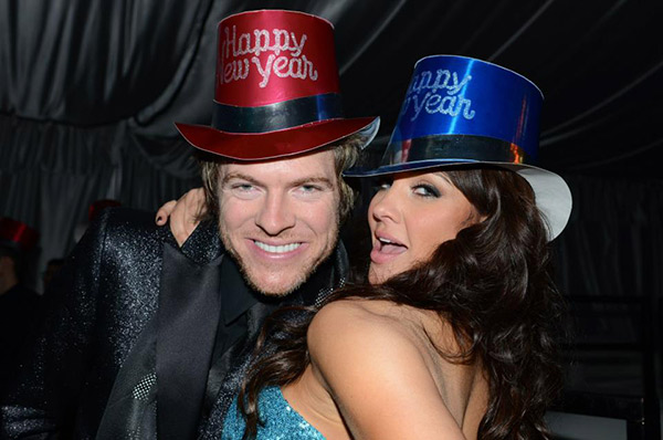 Joe Don Rooney of the country trio Rascal Flatts poses with his wife, Playboy Playmate of the Year 2005, Tiffany Fallon at the New Year's Eve celebration at the Playboy Mansion on Dec. 31, 2012.