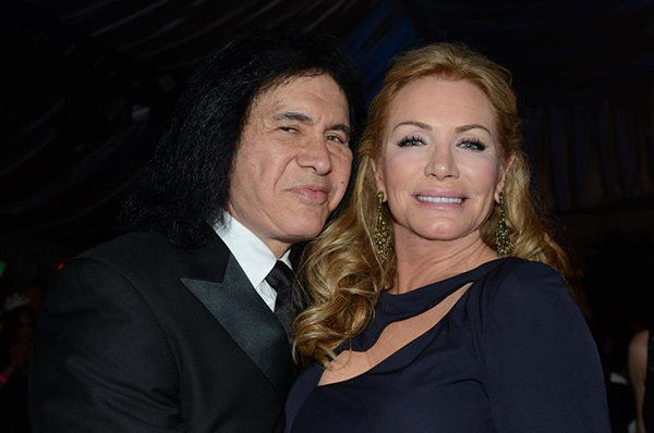 KISS rocker Gene Simmons and partner an Playboy Playmate Shannon Tweed pose at the New Year's Eve celebration at the Playboy Mansion on Dec. 31, 2012. Playbo