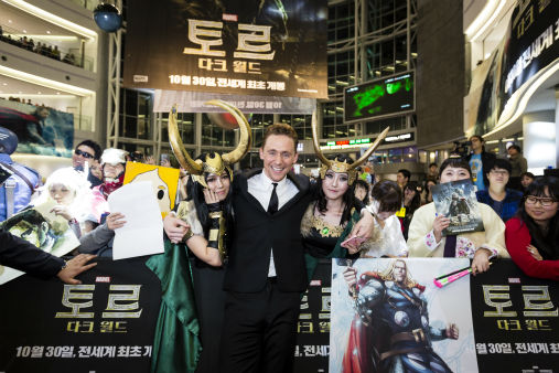Tom Hiddleston poses with fans at 'Thor: The Dark World' fan event in Seoul, South Korea on