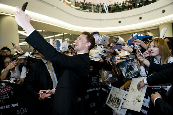 "<div class=""meta image-caption""><div class=""origin-logo origin-image ""><span></span></div><span class=""caption-text"">Tom Hiddleston takes a selfie for a fan at a 'Thor: The Dark World' fan event in Seoul, South Korea on Oct. 14, 2013. (Ho Chang / Walt Disney Studios)</span></div>"