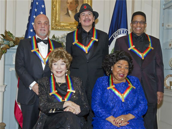 "<div class=""meta ""><span class=""caption-text "">The 2013 Kennedy Center honorees -- opera singer Martina Arroyo; pianist,  keyboardist, bandleader and composer Herbie Hancock; pianist, singer and songwriter Billy Joel; actress Shirley MacLaine; and musician and songwriter Carlos Santana -- attend a gala in their honor in Washington, D.C. on Dec. 8, 2013. (Ron Sachs / Startraksphoto.com)</span></div>"