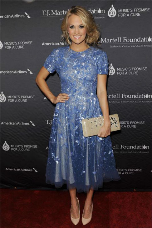 Carrie Underwood appears at the T.J. Martell Foundation&#39;s 38th Annual Honors Gala in New York on Oct. 22, 2013. The country star, who wore a beaded, tulle periwinkle-colored Randi Rahm cocktail dress, was given the 2013 Artist Acheivement Award at the event. The T.J. Martell Foundation funds medical research aimed at finding cures for leukemia, cancer and AIDS.  <span class=meta>(Bill Davila &#47; Startraksphoto.com)</span>