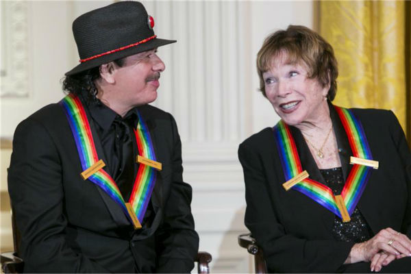Carlos Santana and actress Shirley MacLaine attend a ceremony for the 2013 Kennedy Center honorees in Washington D.C. on Dec. 8, 2013. The two were one of the five. <span class=meta>(Kristoffer Tripplaar &#47; POOL &#47; Startraksphoto.com)</span>