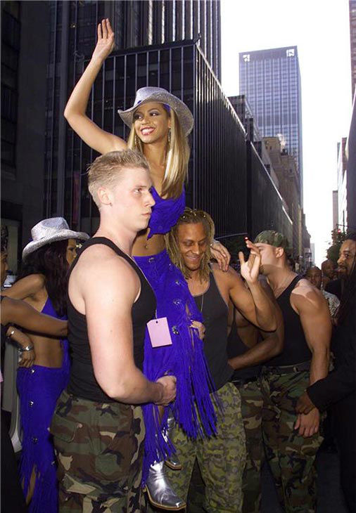 Beyonce of Destiny's Child gets a lift to a group event at the Coconuts movies and music store in New York on May 1, 2001.