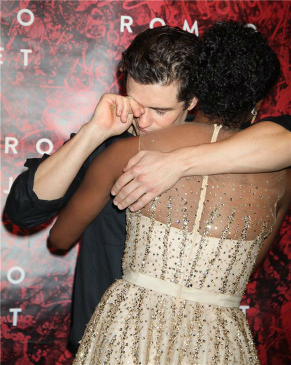 Orlando Bloom hugs co-star Condola Rashad at the opening night party for the play 'Romeo and Juliet,' which marks the actor's Broadway debut, in New York on Sept. 19, 2013.