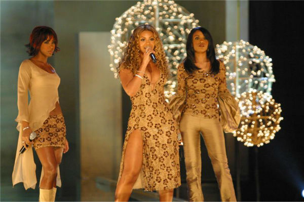 Destiny's Child members Kelly Rowland, Beyonce and Michelle Williams perform at the 8th annual Victoria's Secret Fashion Show at the Lexington Avenue Armory in New York on Nov. 14, 2002.
