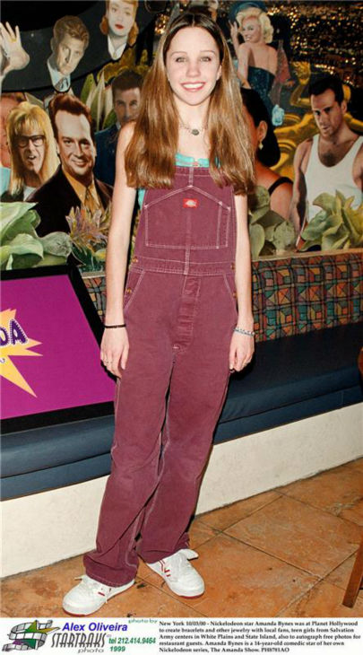 Nickelodeon star Amanda Bynes, 14, appears at Planet Hollywood in New York to create bracelets and other jewelry with local fans, teen girls from Salvation Army centers in White Plains and State Island, and to autograph free photos for restaurant guests on Oct. 3, 2000. <span class=meta>(Startraksphoto.com)</span>