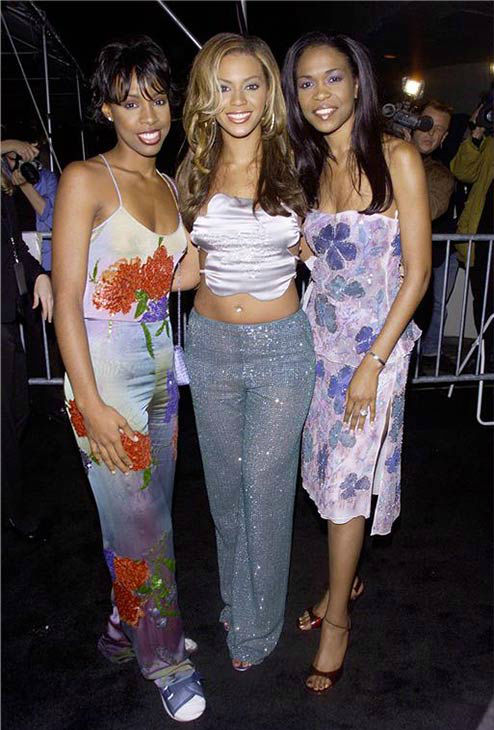 Destiny&#39;s Child members Kelly Rowland, Beyonce and Michelle Williams appear at the opening of the Giorgio Armani retrospective at the Guggenheim Museum in New York on Oct. 18, 2000. <span class=meta>(Startraksphoto.com)</span>