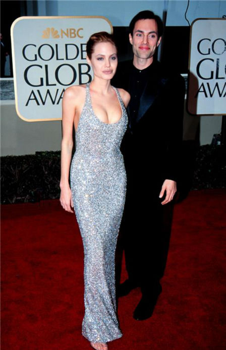 Angelina Jolie and her brother, James Haven, walk the red carpet at the 1999 Golden Globe Awards in Beverly Hills, California on Jan. 17, 1999.