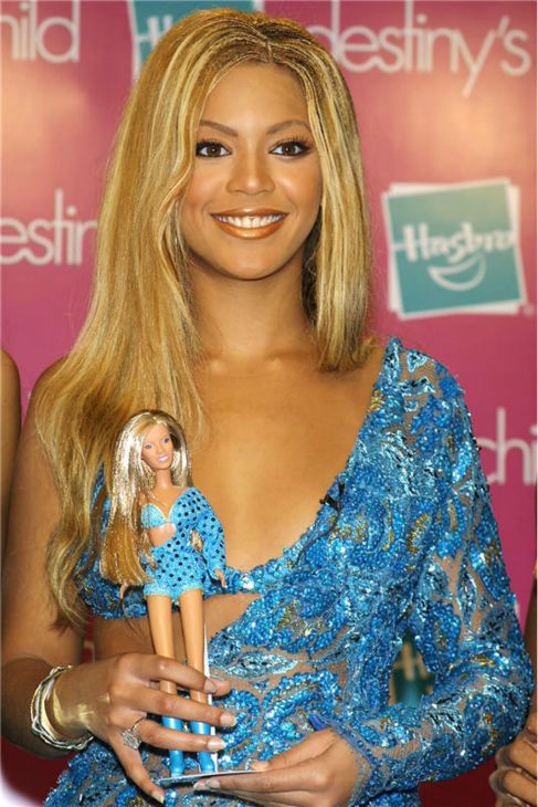 Beyonce holds a doll make in her likeness at a toy fair in New York on Sept. 7, 2001.