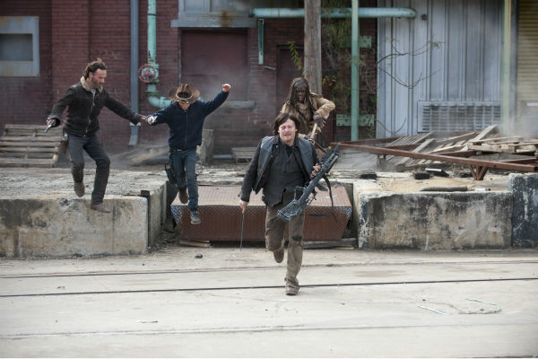 Rick Grimes &#40;Andrew Lincoln&#41;, Carl Grimes &#40;Chandler Riggs&#41;, Daryl Dixon &#40;Norman Reedus&#41; and Michonne &#40;Danai Gurira&#41; run from snipers in Terminus in this scene from AMC&#39;s &#39;The Walking Dead&#39; season 4 finale, which aired on March 30, 2014. <span class=meta>(Gene Page &#47; AMC)</span>