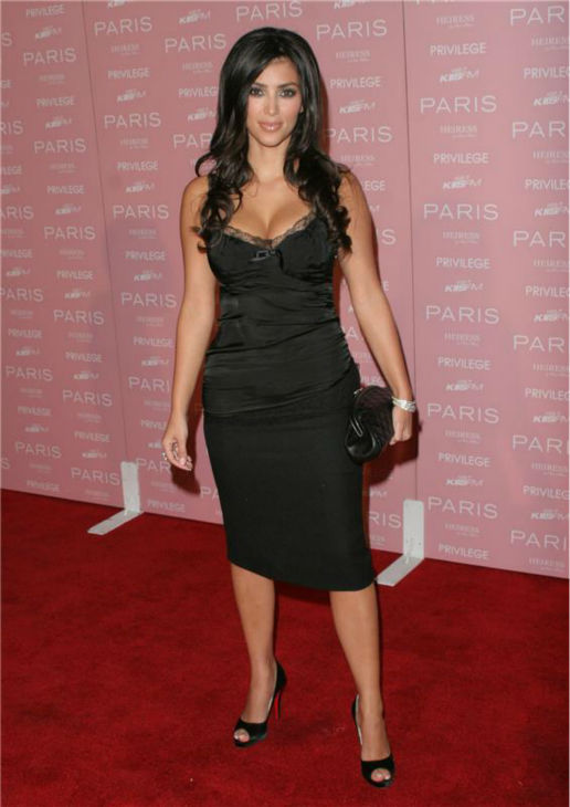 Kim Kardashian attends the launch party for Paris Hilton's CD 'Heiress' in Hollywood, California on Aug. 18, 2006.