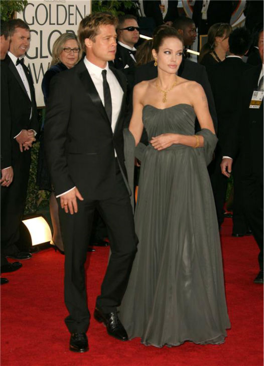 Angelina Jolie and Brad Pitt walk the red carpet at the 2007 Golden Globe Awards in Beverly Hills, California on Jan. 15, 2007.