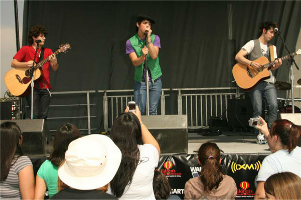 Before they were packing major arenas around the world, there was that time that the Jonas Brothers performed in front of a Walmart in California.  &#40;Pictured: Nick, Joe and Kevin Jonas perform before fans at a Walmart in Duarte, California on April 30, 2007.&#41; <span class=meta>(Clark Samuels &#47; Startraksphoto.com)</span>