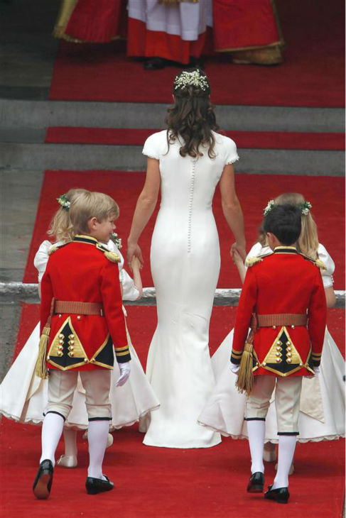 Pippa Middleton appears at her sister Kate Middleton&#39;s Royal Wedding to Prince William at Westminster Abbey in London on April 29, 2011. Pippa became famous due to her a cowl-neck, body-hugging, ivory bridesmaid gown by Sarah Burton at Alexander McQueen. <span class=meta>(Guido Ohlenboste &#47; Startraksphoto.com)</span>