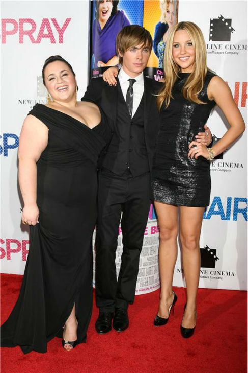 Amanda Bynes poses with 'Hairspray' co-stars Nikki Blonski and Zac Efron at the film's premiere in New York