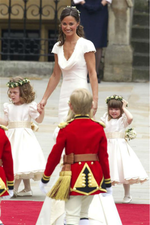 Pippa Middleton appears at her sister Kate Middleton's Royal Wedding to Prince William at Westminster Abbey in London on April 29, 2011. Pippa became famous due to her a cowl-neck, body-hugging, ivory bridesmaid gown by Sarah Burton at Alexander McQueen.