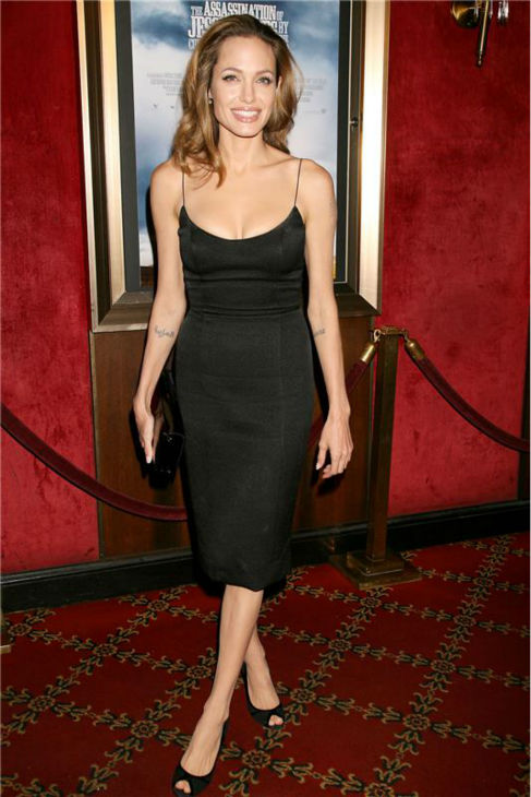 Angelina Jolie wears a L&#39;Wrenn Scott Fall 2007 dress to the premiere of &#39;The Assassination of Jesse James,&#39; which stars her partner Brad Pitt, in New York on Sept. 18, 2007. <span class=meta>(Dave Allocca &#47; Startraksphoto.com)</span>