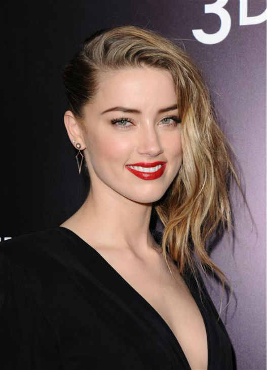 Amber Heard, Johnny Depp&#39;s reported fiancee, appears at the premiere of the movie &#39;3 Days To Kill&#39; in Los Angeles on Feb. 12, 2014.  She is one of the cast members. It was reported in January that the two are engaged, although the pair has not confirmed this. <span class=meta>(Sara De Boer &#47; Startraksphoto.com)</span>
