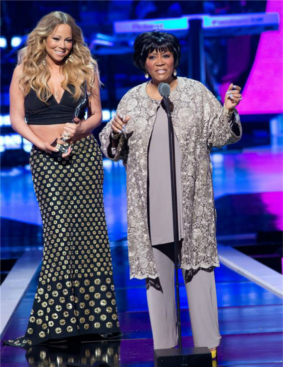 Mariah Carey presents godmother Patti LaBelle with the Living Legend Award at BET&#39;s 2013 Black Girls Rock event at the New Jersey Performing Arts Center in Newark, New Jersey on Oct. 26, 2013. <span class=meta>(Marcus Owen &#47; Startraksphoto.com)</span>