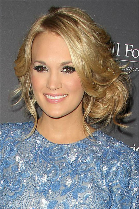 Carrie Underwood appears at the T.J. Martell Foundation&#39;s 38th Annual Honors Gala in New York on Oct. 22, 2013. The country star, who wore a beaded, tulle periwinkle-colored Randi Rahm cocktail dress, was given the 2013 Artist Acheivement Award at the event. The T.J. Martell Foundation funds medical research aimed at finding cures for leukemia, cancer and AIDS.  <span class=meta>(Amanda Schwab &#47; Startraksphoto.com)</span>