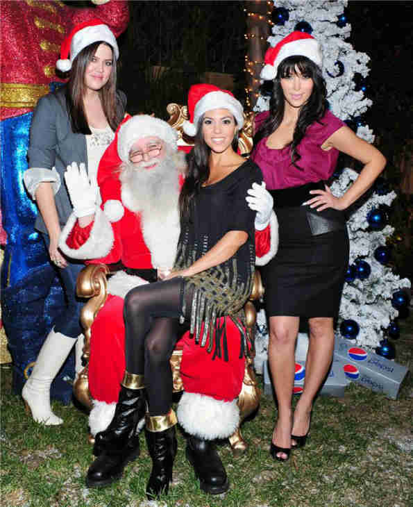Khloe, Kourtney and Kim Kardashian pose with Santa at the Pepsi Holiday House, benefitting Clothes Off Our Back and Feeding America, in Los Angeles on Dec. 12, 2008. <span class=meta>(Albert Michael &#47; Startraksphoto.com)</span>