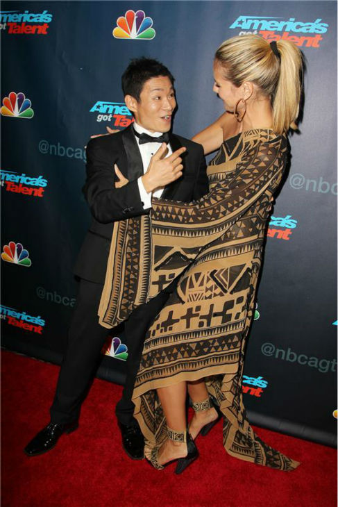 "<div class=""meta ""><span class=""caption-text "">'America's Got Talent' co-judge Heidi Klum embraces season 8 winner and dancer Kenichi Ebina on the red carpet after the finale at Radio City Music Hall in New York on Sept. 19, 2013. (Amanda Schwab / Startraksphoto.com)</span></div>"
