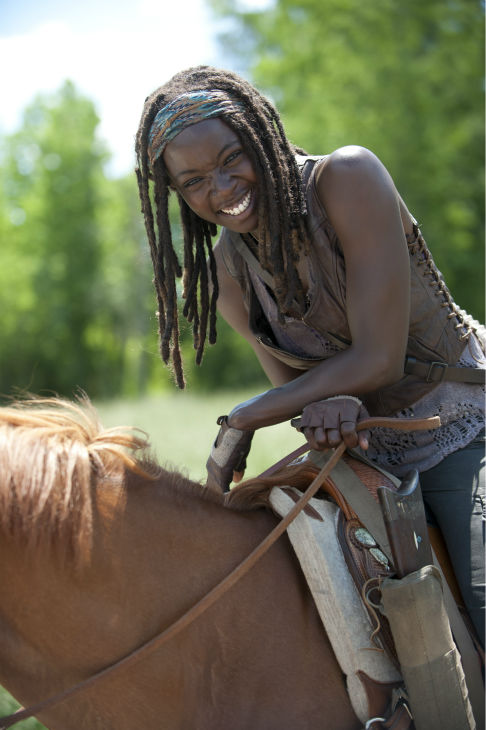 "<div class=""meta image-caption""><div class=""origin-logo origin-image ""><span></span></div><span class=""caption-text"">Danai Gurira (Michonne) rides a horse on the set of AMC's 'The Walking Dead' while filming episode 2 of season 4, titled 'Infected,' which aired on Oct. 20, 2013.  (Gene Page / AMC)</span></div>"