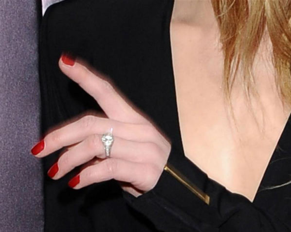 Johnny Depp&#39;s reported fiancee Amber Heard wears a diamond ring at the premiere of the movie &#39;3 Days To Kill&#39; in Los Angeles on Feb. 12, 2014. It was reported in January that the two are engaged, although the pair has not confirmed this. <span class=meta>(Sara De Boer &#47; Startraksphoto.com)</span>